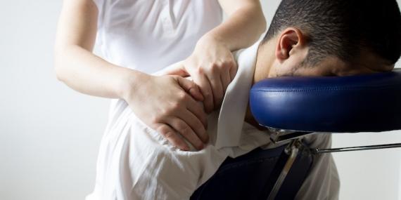 businessman receiving shiatsu on a quick massage chair